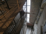 <p>Vertigo-inducing catwalk into the steel multi-tiered East Cell Block from the sixth floor.</p>